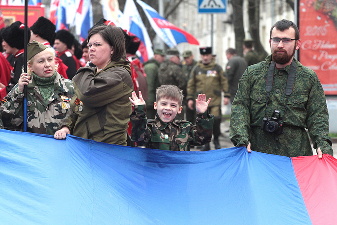People take part in a rally marking the second anniversary of Crimea's reunification with Russia in Simferopol