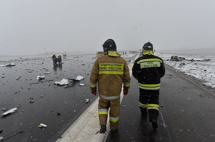 A Russian Emergency Ministry employee at the site of the crash