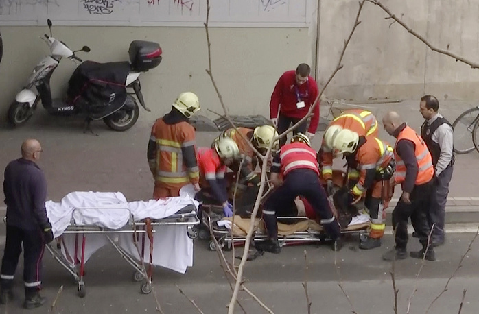 Emergency rescue workers at the site of an explosion at a metro station in Brussels