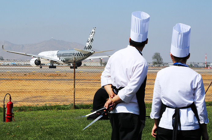 Chefs looking at an Airbus A350 XWB long range jet airliner