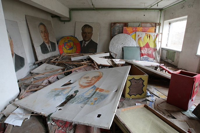 Posters featuring portraits of the Soviet Union's Communist Party officials in an abandoned culture center in Pripyat near the Chernobyl power station