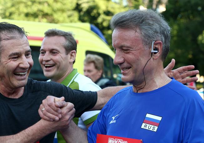Sberbank CEO Herman Gref (right)