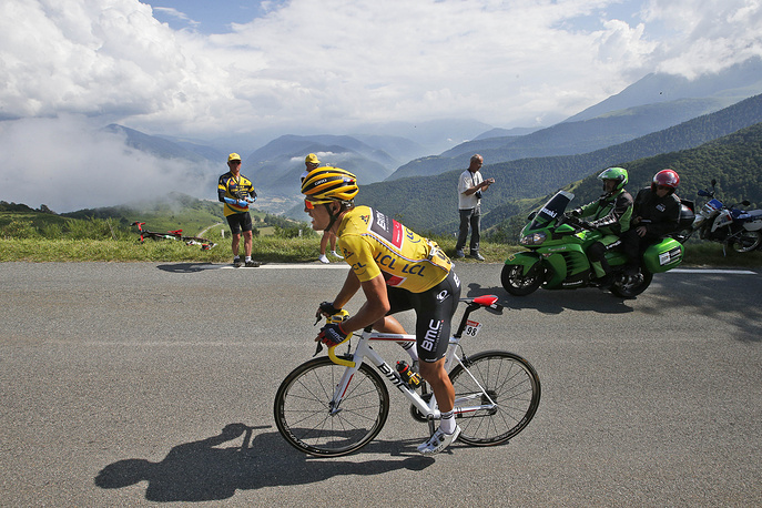 Belgium's Greg van Avermaet in leader's yellow jersey climbing Aspin pass