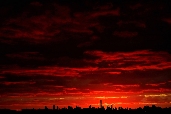 The sun sets over Manhattan, New York, September 6