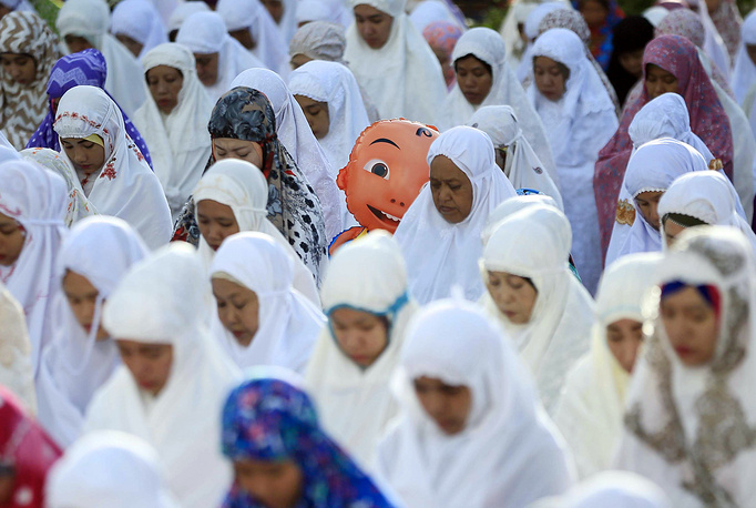 Indonesian Muslims attend the Eid al-Adha prayers in Medan, North Sumatra, Indonesia