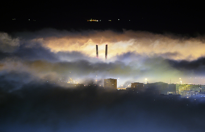 Mist covers Zolotoy Bridge across the Golden Horn Bay, Vladivostok, July 7