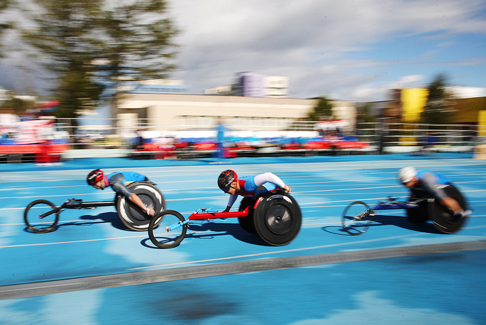Athletes compete during a track and field event at the All-Russian Paralympic Contest, September 8