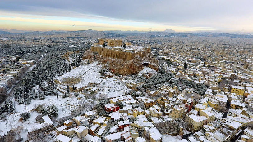 The Parthenon temple seen atop of the snow-covered Acropolis hill in Athens, Greece, January 10