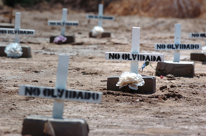 The graves of unidentified migrants who died while crossing the US-Mexico border in a public cemetery in Holtville, California, USA
