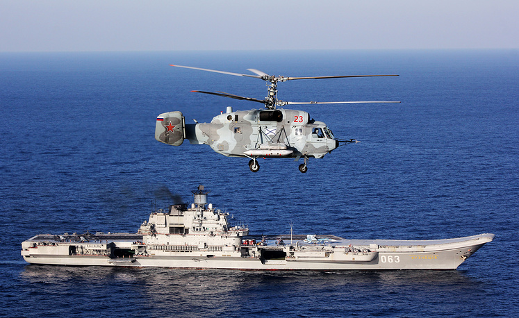 A Kamov Ka 52 helicopter over Russia's Admiral Kuznetsov aircraft carrier in the Mediterranean Sea, November 24, 2016