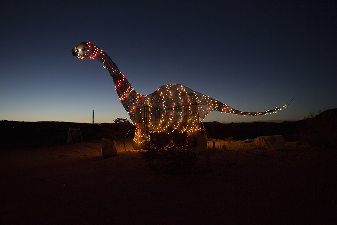 A dinosaur statue stands outside a store off the highway in Terlingua, Texas, near the US-Mexico border, March 27