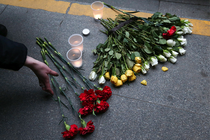 Flowers and candles at Spasskaya station in Saint Petersburg