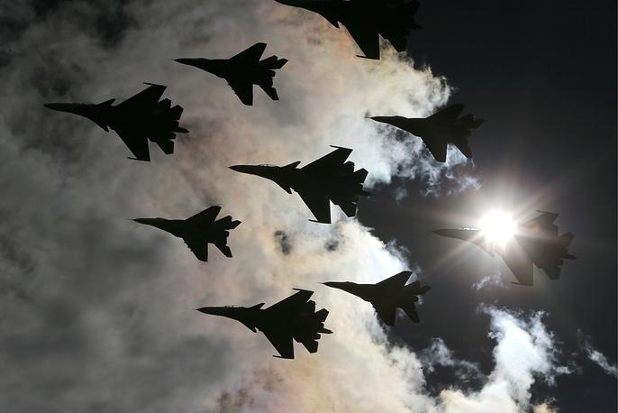 MiG-29 fighter jets of the Strizhi aerobatic team and Sukhoi Su-30SM fighter jets of the Russkiye Vityazi aerobatic team