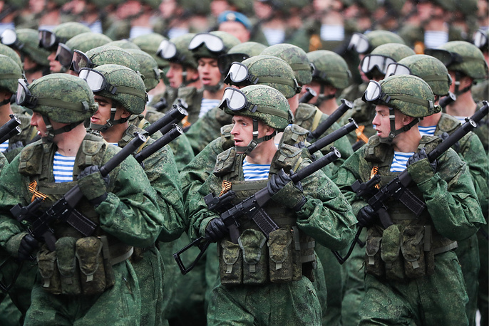 Servicemen march in formation in Moscow's Red Square