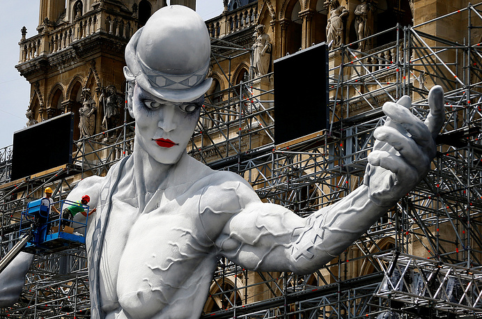 Workers set-up the stage for the 24th Life Ball in front of the city hall in Vienna, Austria, June 6