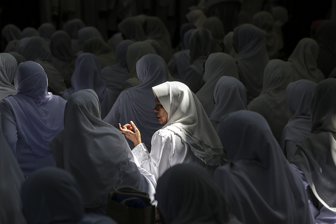 Malaysian Muslim women chats during Koran reciting programme at a mosque during the holy fasting month of Ramadan in Kuala Lumpur, Malaysia, June 11