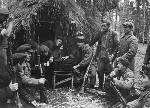 Soviet partisans, members of resistance movements that fought a guerrilla war against the Nazis, listening to a radio message broadcasted by the Soviet Information Bureau, September 1, 1941