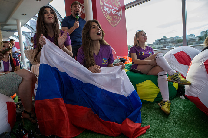 Football fans watch a live broadcast of the 2017 FIFA Confederations Cup Group A match between Russia and Portugal on the FootBoat cruise ship