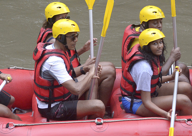 Former US President Barack Obama, his wife Michelle and daughter Sasha raft on the Ayung River in Badung, on Bali island, Indonesia, June 26