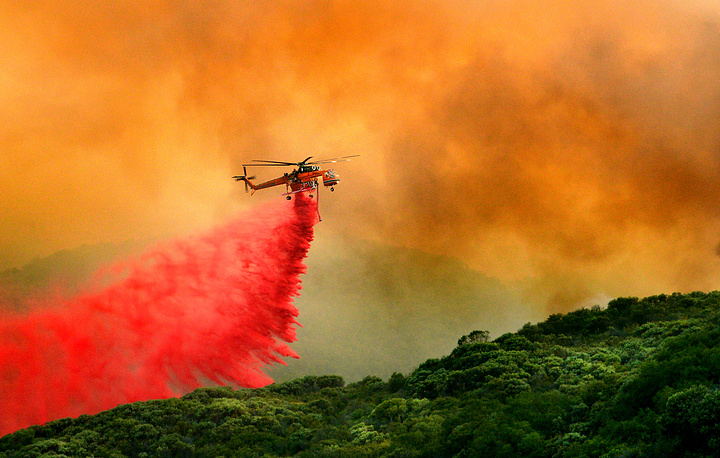 A fire service helicopter drops flame retardant on the 'Whittier' wildfire in Santa Barbara County, California, USA, July 11