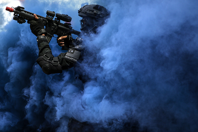 A member of the Royal Malaysian Police Special Tactical Unit takes part in a security drill simulating rescue of hostages in preparation for the upcoming South East Asian Games (SEA GAMES) at KL Sentral in Kuala Lumpur, Malaysia, July 20