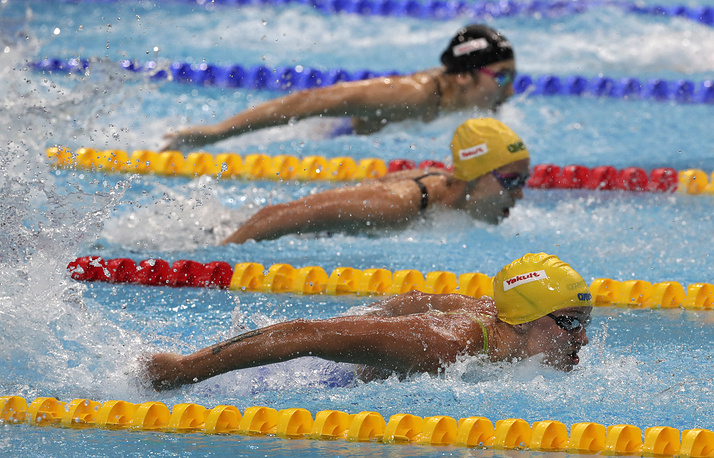 Sweden's gold medal winner Sarah Sjostrom, Australia's Emma McKeon and Japan's Runa Imai compete in the women's 100-meter butterfly final