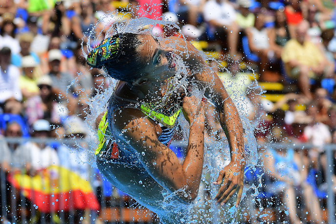 A member of the United States' team performs during the women's team free synchronized swimming final free routine