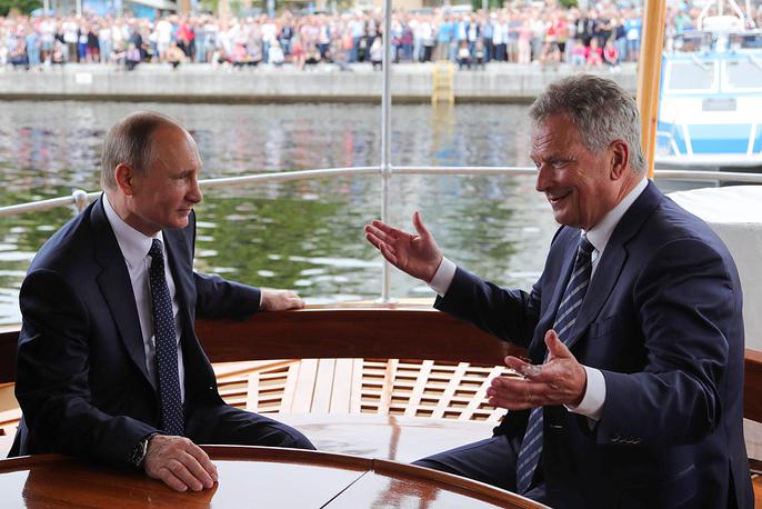 Russia's President Vladimir Putin and Finland's President Sauli Niinisto on the Saimaa steamboat on Lake Pihlajavesi, Finland, July 27