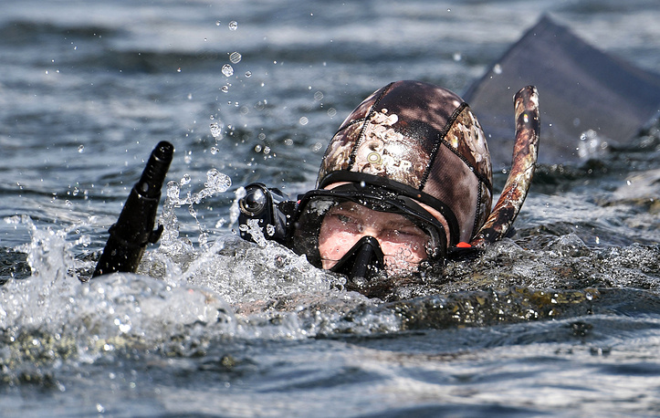 Vladimir Putin spent two hours in a diving suit underwater chasing an evasive pike