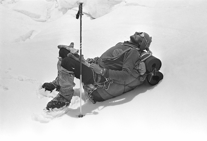 A climber stopped for a rest while crossing the Khumbu Glacier, 1982