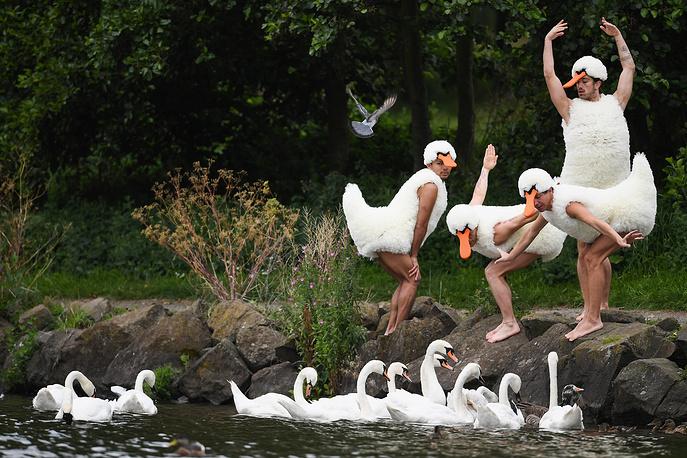 Dancers perform at St Margaret's Loch in their spoof Swan Lake costumes in Edinburgh, Scotland, August 10