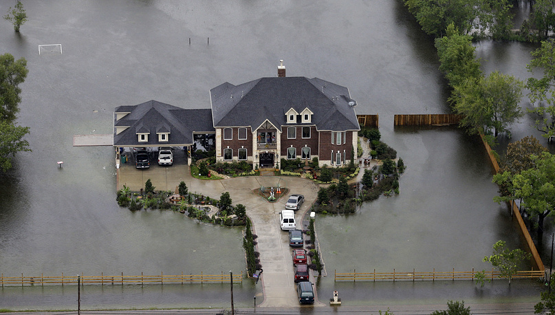 A home is surrounded by floodwaters from Tropical Storm Harvey in Houston, USA, August 29