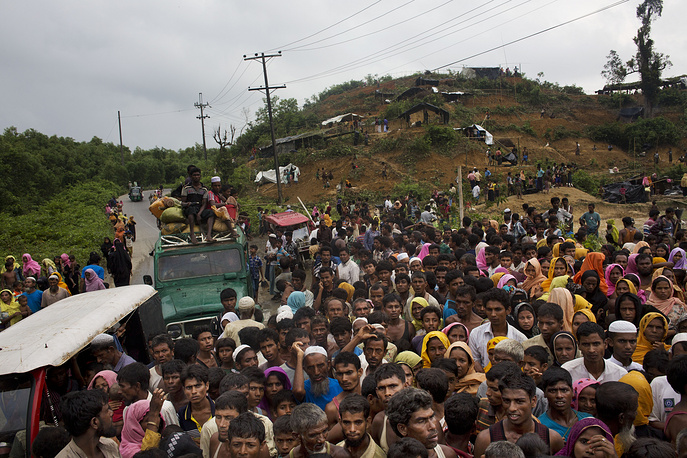 Newly arrived Myanmar's Rohingya ethnic minority refugees scuffle for food rations distributed by Bangladeshi volunteers