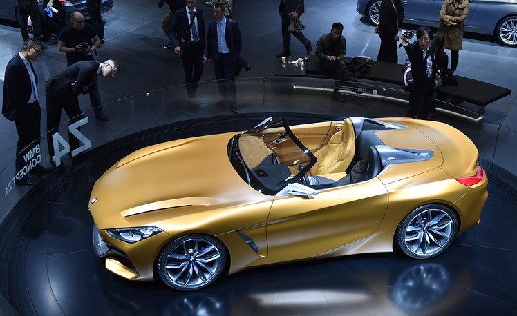 Visitors surround a BMW Concept Z4