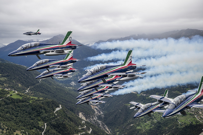 The Breitling DC-3, HB-IRJ, plane fly escorted by Italian Air Force's aerobatic demonstration team, the Frecce Tricolori, during the last stage of its world tour in Sion, Switzerland, September 13