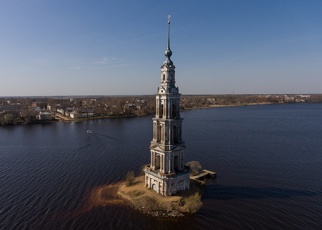An aerial view of the St Nicholas Monastery bell tower at the Uglich Reservoir on the Volga River. In 1939, the central part of the ancient town of Kalyazin was flooded to form the reservoir during the construction of the Uglich Dam