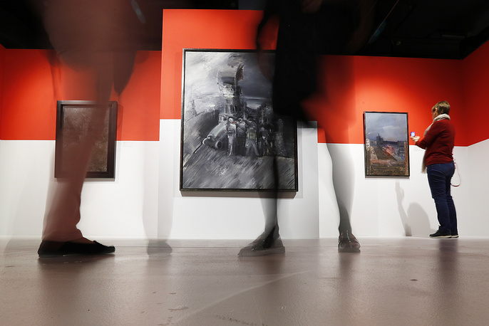 People attend an exhibition of graphic works and paintings of Soviet and Russian painter Alexander Labas, titled October, marking the 100th anniversary of the October Revolution, at the Institute of Russian Realist Art, Moscow, Russia, September 26