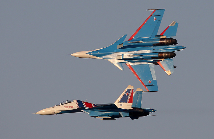 Sukhoi Su-30SM jet fighters of the Russkiye Vityazi aerobatic team perform at the 2017 Dubai Airshow