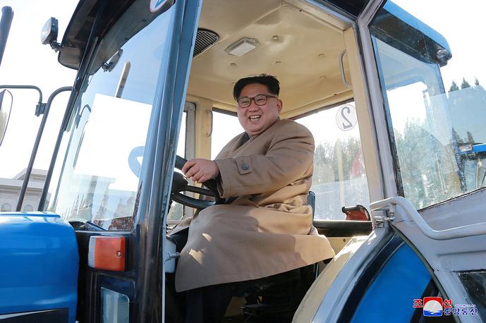North Korean leader Kim Jong Un gets behind the wheel at the Kumsong Tractor Factory in Pyongyang, North Korea, November 15