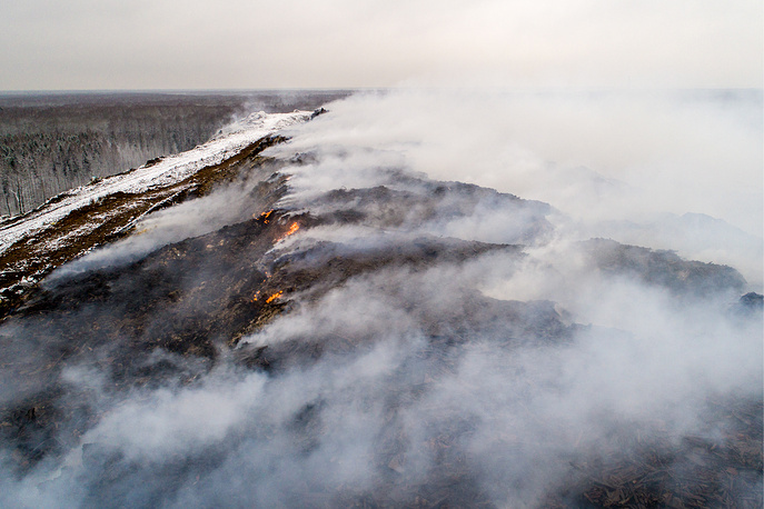 Smoke rises over Syanovo 1 solid waste landfill in the Serpukhov District, Moscow region, Russia, November 21