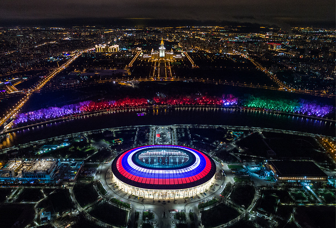 Moscow's Luzhniki Stadium is lit with the white, blue, and red colours of the Russian national flag