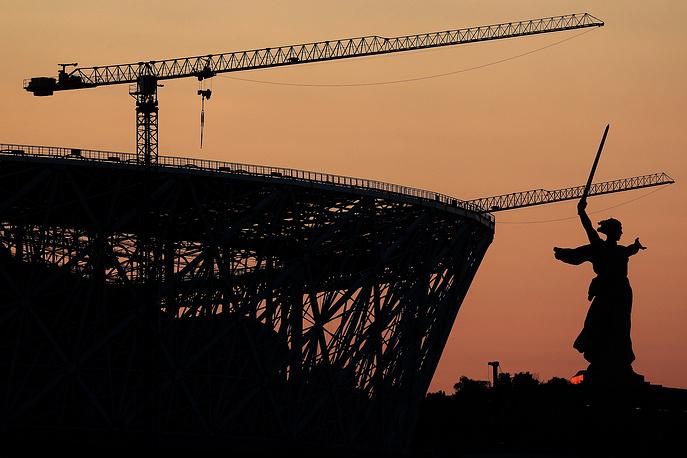 A view of Volgograd Arena Stadium under construction and the Motherland Calls monument on Volgograd's Mamayev Kurgan
