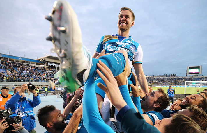 Zenit St Petersburg players toss Nicolas Lombaerts as he is leaving the club after a 2016/2017 Russian Football Premier League Round 29 football match between Zenit St Petersburg and FC Krasnodar at Petrovsky Stadium, St Petersburg, May 17