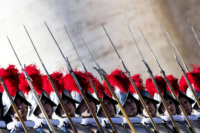 Swiss guards as Pope Francis delivers the Urbi et Orbi Christmas Day message from the central balcony of St. Peter's Basilica at the Vatican, 25 December