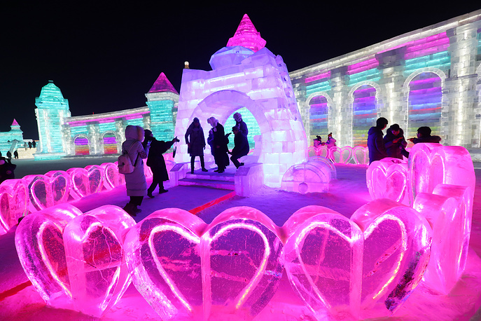 People visit the ice sculptures at Harbin ice and snow world d