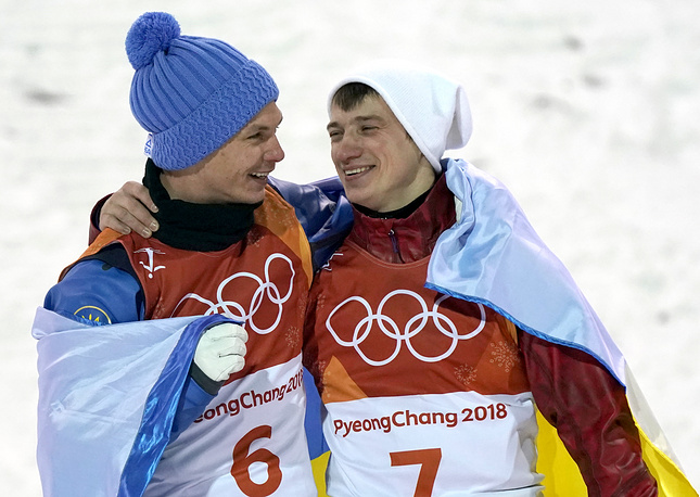 Gold medal winner Olexandr Abramenko of the Ukraine and bronze medal winner Ilja Burow from the Olympic Athletes of Russia celebrate on the podium for the venue ceremony of Men's Freestyle Skiing Aerials final competition