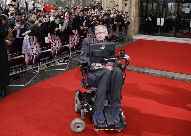 Professor Stephen Hawking poses for photographers upon arrival for the Interstellar Live show at the Royal Albert Hall in central London, Britain