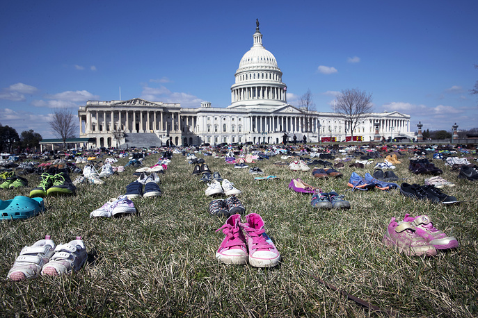 Approximately 7,000 pairs of shoes representing children who lost their lives to gun violence since the December 14, 2012 shooting at Sandy Hook Elementary School in Newtown, Connecticut, are seen on the East Front of the US Capitol in Washington, USA, March 13