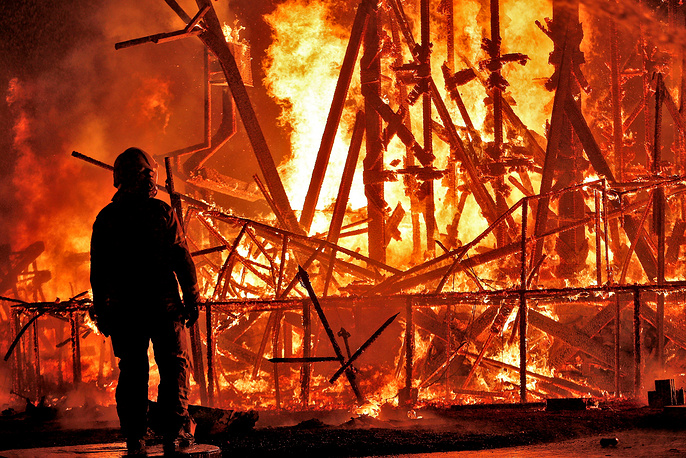A fireman watches the Municipal Falla burning in Valencia