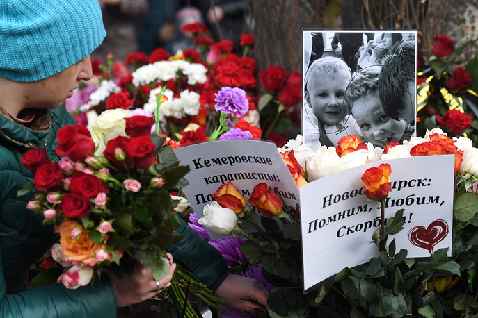 Flowers outside the Zimnyaya Vishnya shopping centre in Kemerovo where people were killed in a fire on March 25